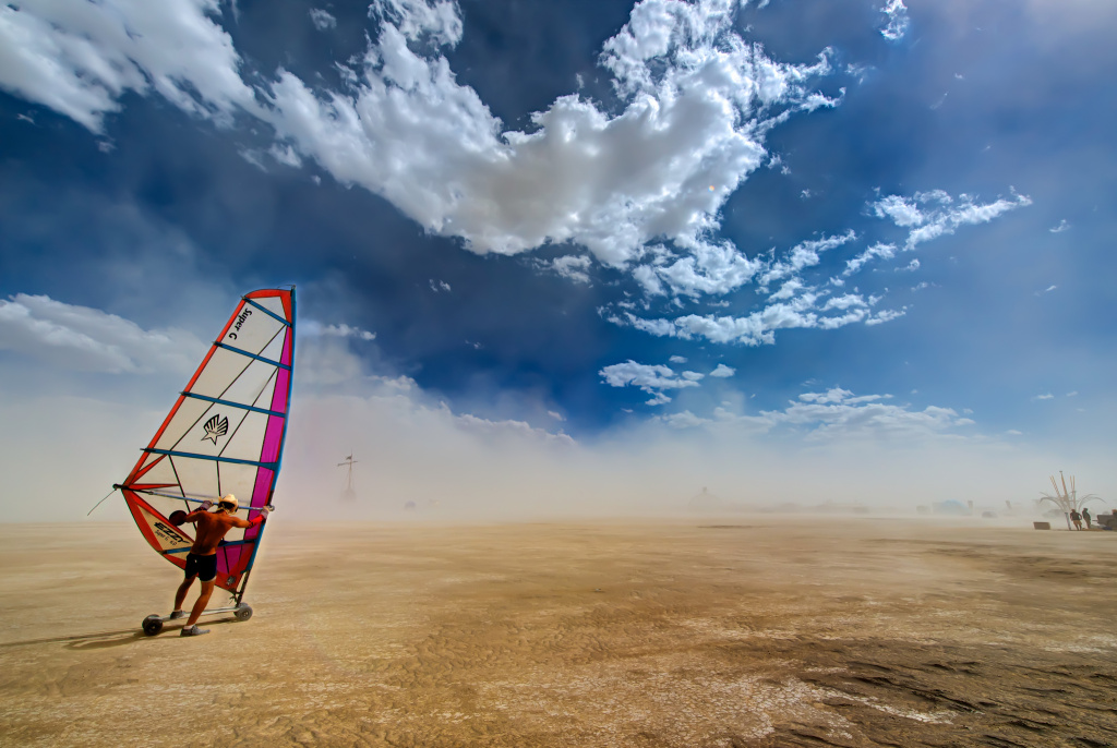 Rare storms turned the Burning Man playa into a muddy mess Monday, and thousands of anticipating attendees were left out in the rain.