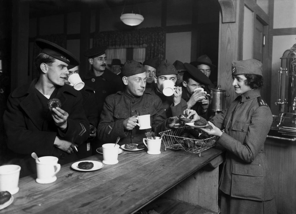 American servicemen enjoy a hot cup of coffee at a Salvation Army hut in New York, circa 1918. During World War I, instant coffee was a key provision for soldiers on the front. They called it a
