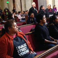 A crowd of around 200 people gathered in the L.A. City Council chambers for a heated economic development committee hearing on whether to legalize street vending, Tuesday, December 2, 2014.