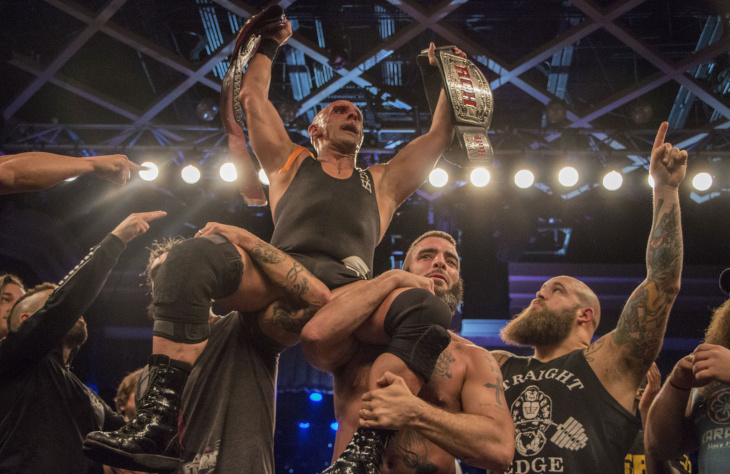 Wrestlers celebrate with Christopher Daniels after he wins the Ring Of Honor world championship on March 10, 2017.
