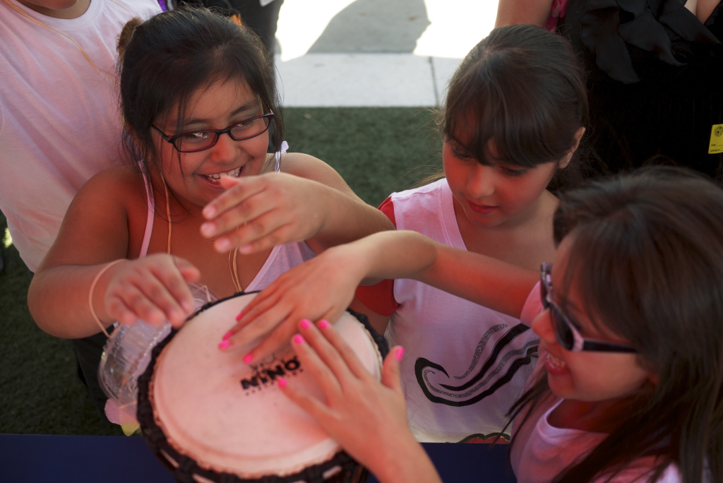 Students play a drum at the Very Special Arts Festival in downtown Los Angeles, October 18, 2013.