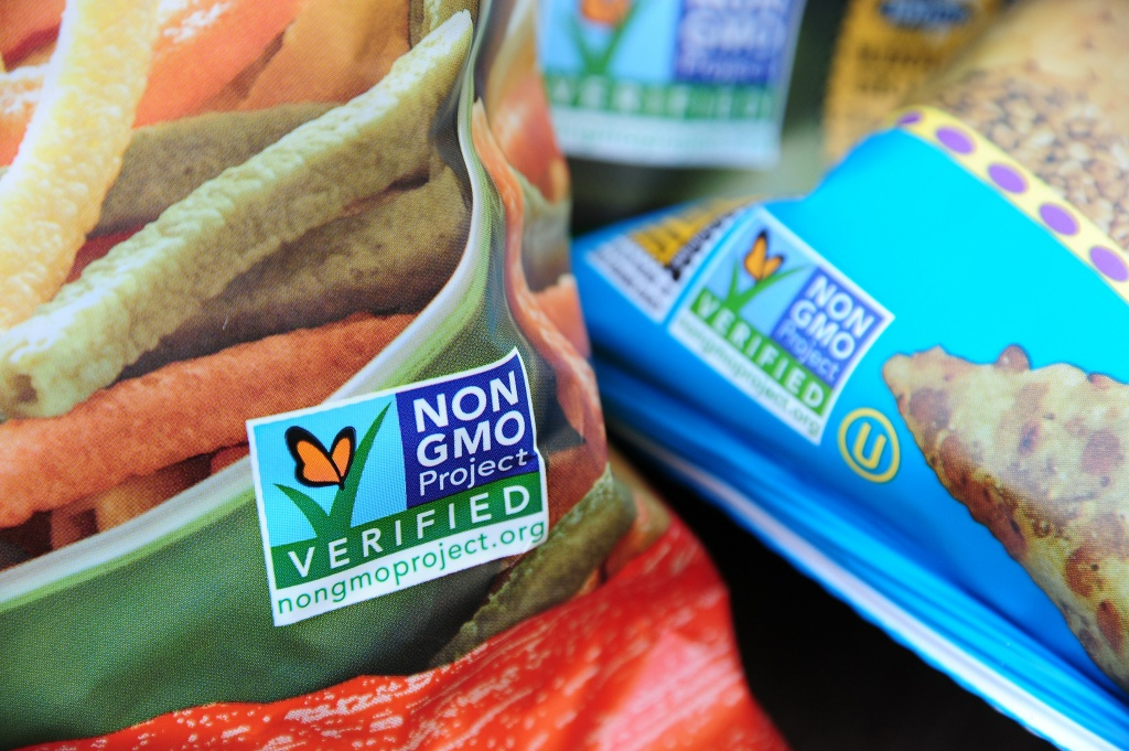 Labels on bags of snack foods indicate they are non-GMO food products, in Los Angeles, California, October 19, 2012.