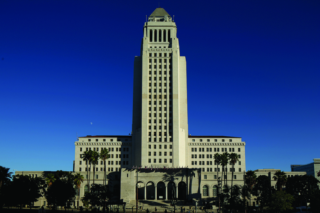The Los Angeles City Council will consider a motion Tuesday that would nearly double hourly wages for hotel workers.