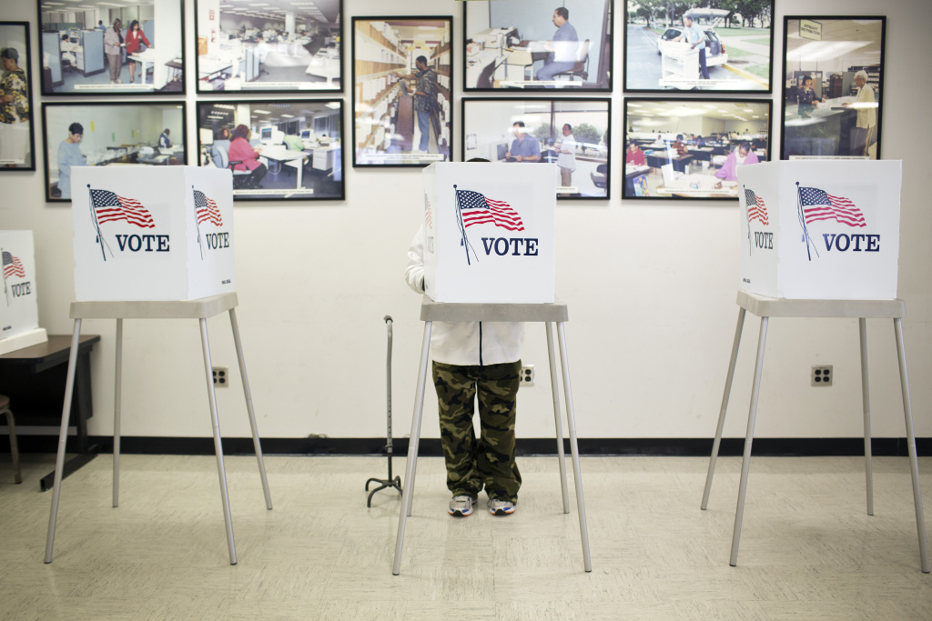 This file photo shows voting booths at the Los Angeles County Registrar/Recorder building in Norwalk on Friday, Oct. 17, 2014.
