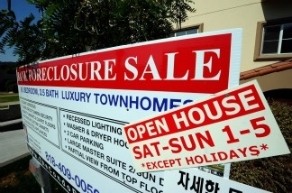 A bank foreclosure sale sign is posted in front of townhouses on Aug. 12, 2010 in Los Angeles.