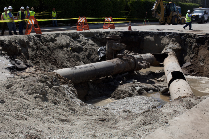 The rupture in the water main under Sunset Boulevard is visible where the two pipes converge. The other hole in the pipe, at right, is a result of the Los Angeles Department of Water & Power attempting to plug the flow of water. DWP expects to have the road patched by Saturday.