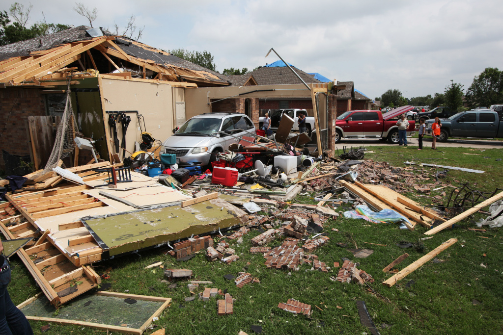 A family van is exposed after the garage was blown apart May 16, 2013 in Cleburne, Texas.