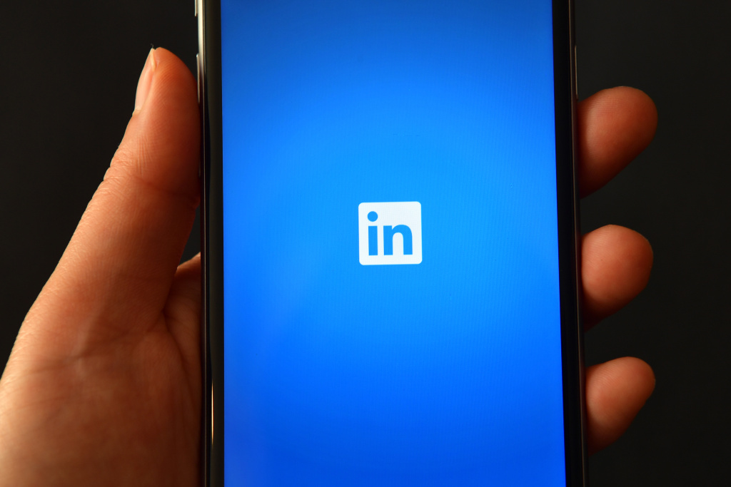 The LinkedIn logo is displayed on an iPhone on August 3, 2016.
