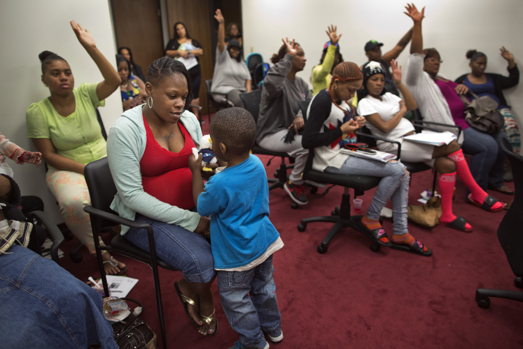 Kenisha Norwood, left, and her 3-year-old son Xavier attend a social support and empowerment class for pregnant mothers put on by Great Beginnings for Black Babies at Freeman Medical Arts Building on Monday, Feb. 23.
