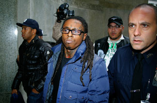 Lil Wayne (C) arrives in court for weapon charges at the New York State Supreme Court on Dec. 15, 2009 in New York City.