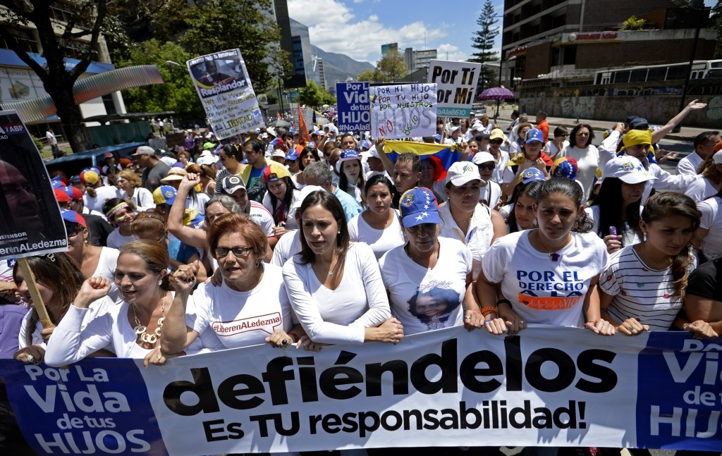 Here, opposition leader Maria Corina Machado, center, marched with opponents of President Nicolas Maduro in Caracas to mark International Women's Day. The crisis in the country hit new levels this week, with a new round of protests planned and Maduro extended a state of emergency.