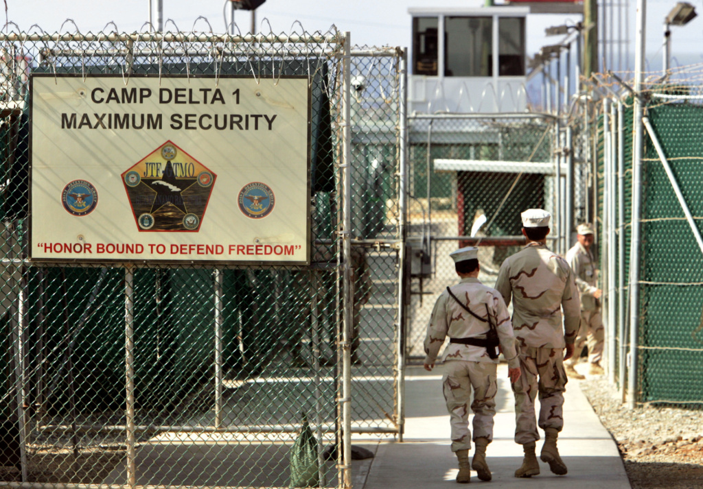 U.S. military guards walk within the Camp Delta military-run prison at the Guantanamo Bay US Naval Base, Cuba, in 2006. Wednesday marks 10 years since detainees first arrived at the detention facility.