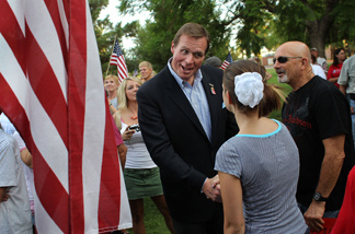 Conservative Republican candidate J.D. Hayworth, currently running against John McCain for the Republican nomination for Arizona's Senate seat, greets the crowd at a demonstration against illegal immigration on July 31, 2010 in Phoenix, Arizona.
