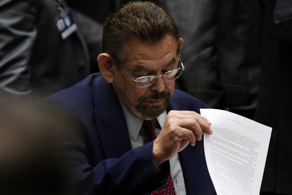 In this file photo, former Bell council member George Mirabal looks over some documents on the opening day of closing arguments session on February 20, 2013 in Los Angeles, California. Mirabal was sentenced on Friday to a year in county jail. He is the first of five council members expected  to be sentenced in the coming weeks.
