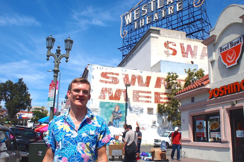 Tom Carroll, of Youtube's Tom Explores Los Angeles, in front of the Westlake Theatre sign at the corner of Wilshire and Alvarado.