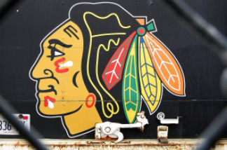 File photo: The Blackhawk's team logo are seen on the back of a truck through a fence outside of the United Center, the home of the Chicago Blackhawks, February 16, 2005 in Chicago, Illinois.