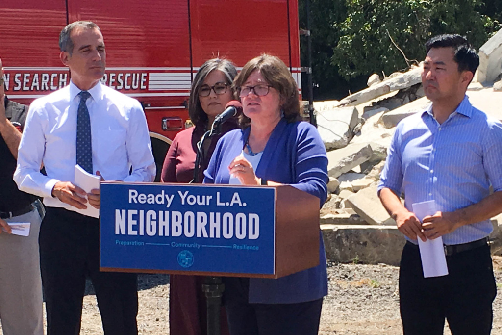 Seismologist Dr. Lucy Jones (at podium) discusses the importance of planning for future earthquakes at a press conference with (from left to right) L.A. Mayor Eric Garcetti and L.A. City Council members Monica Rodriguez and David Ryu.