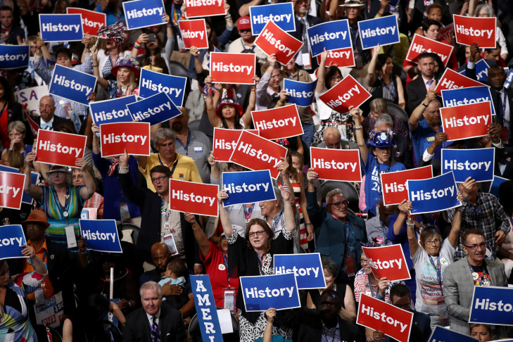 Delegates hold up signs and cheer on the second day of the Democratic National Convention at the Wells Fargo Center, July 26, 2016 in Philadelphia, Pennsylvania.