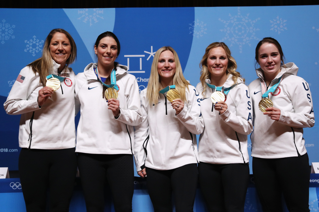 (L-R) Members of the United States Women's Ice Hockey team Meghan Duggan, Hilary Knight, Monique Lamoureux-Morando, Jocelyne Lamoureux-Davidson and Maddie Rooney show their gold medals at a press conference on February 23, 2018 at the 2018 PyeongChang Winter Olympics.