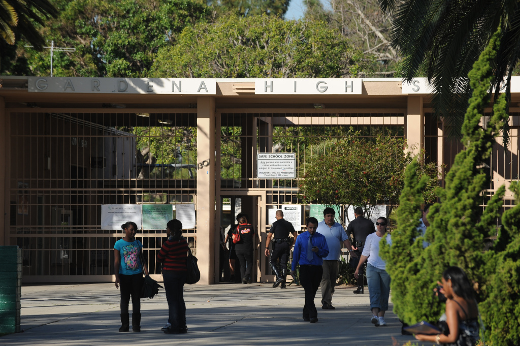 Students and campus police enter Gardena High School in California's South Bay.