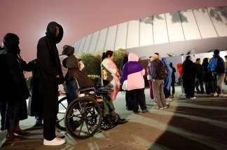 People line up before dawn for free healthcare service at the Remote Area Medical (RAM) clinic at the Los Angeles Sports Arena on April 27, 2010 in Los Angeles, California.