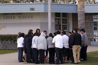 Students gather around a makeshift memorial at E.O. Green middle school, honoring slain school student Lawrence King, 15, who was killed by a classmate because he was gay, in this Feb. 14, 2008 file photo, in Oxnard, Calif.