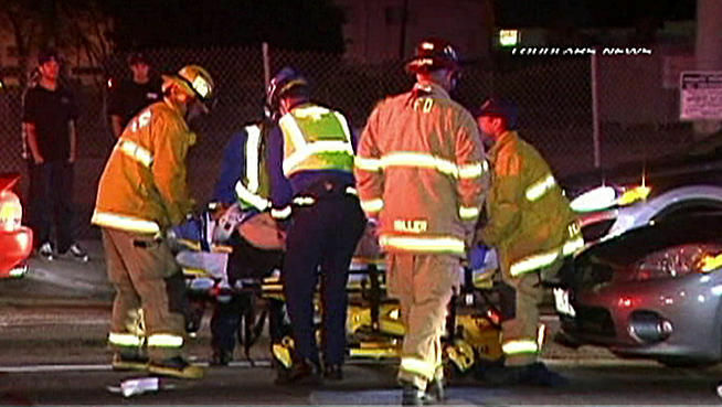 NBC LA footage of officials on the scene where a DUI suspect was stopped after hitting a Torrance man with her car.
