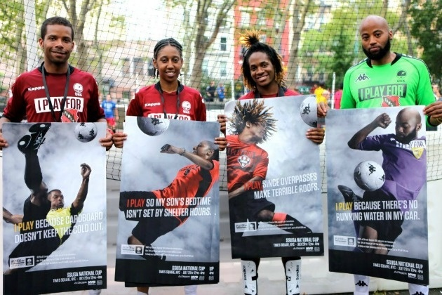 Players hold promotional posters for Street Soccer USA before the West Coast Cup in San Francisco.
