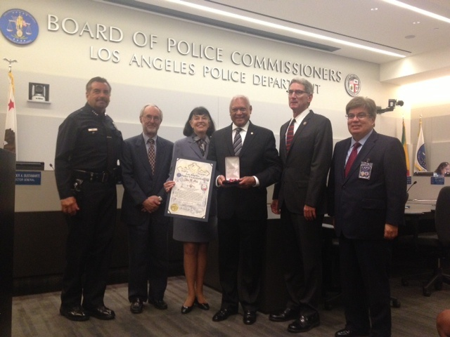 Police Commission and long-time Los Angeles civil rights leader John Mack (center) was honored by his commission colleagues with a distinguished service award for 8 years on the board.