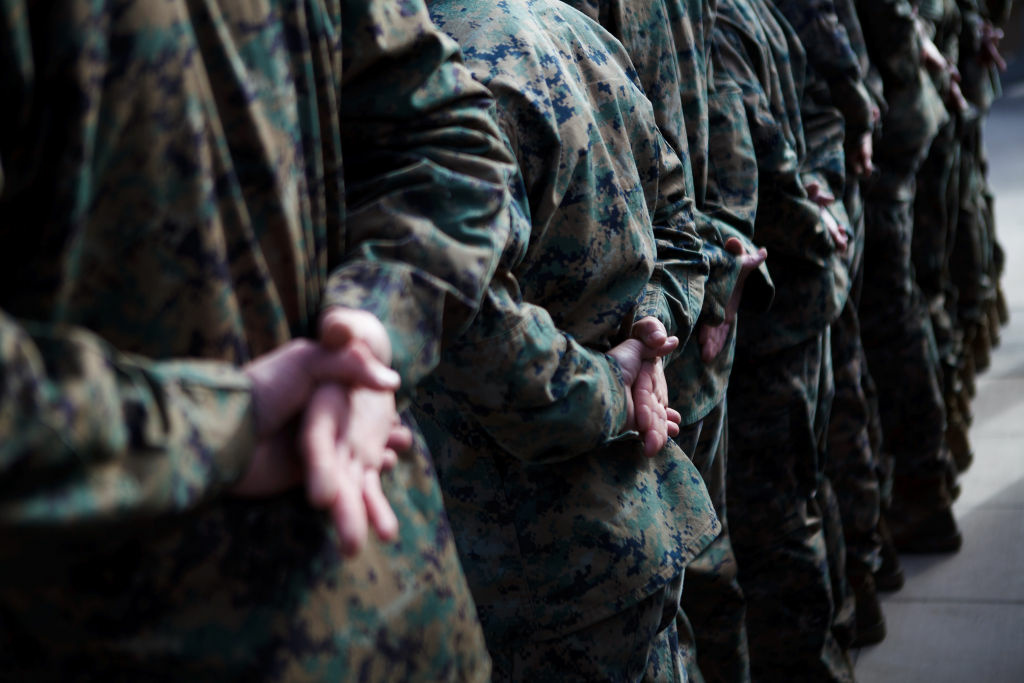 U.S. Marines stand at attention before a service held in honor of Lance Cpl. Donald Hogan January 17, 2012 in Camp Pendleton, California. A memorial for 5th Marine Regiment members, like Hogan, who were killed in Afghanistan, was unveiled Thursday.