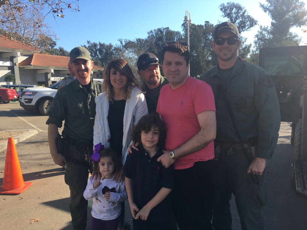Sally Barati, her husband Shawn Babaieamin and their children had been trapped in their home for three days before these deputies from the Santa Barbara County Sheriff's Department rescued them from a second story window.