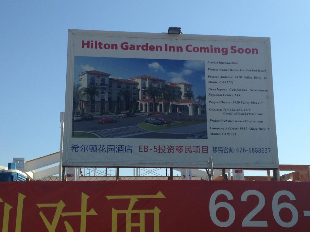 A poster for a hotel under construction on Valley Boulevard in El Monte, financed using EB-5 foreign investor funds. The city hopes to attract more investment.