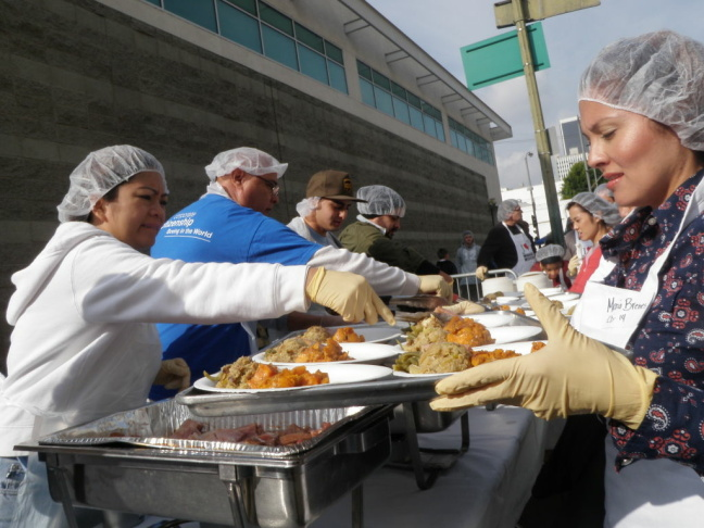 About 350 volunteers helped pass out holiday meals to the homeless on Thanksgiving 2011 at the Los Angeles Midnight Mission on Skid Row.