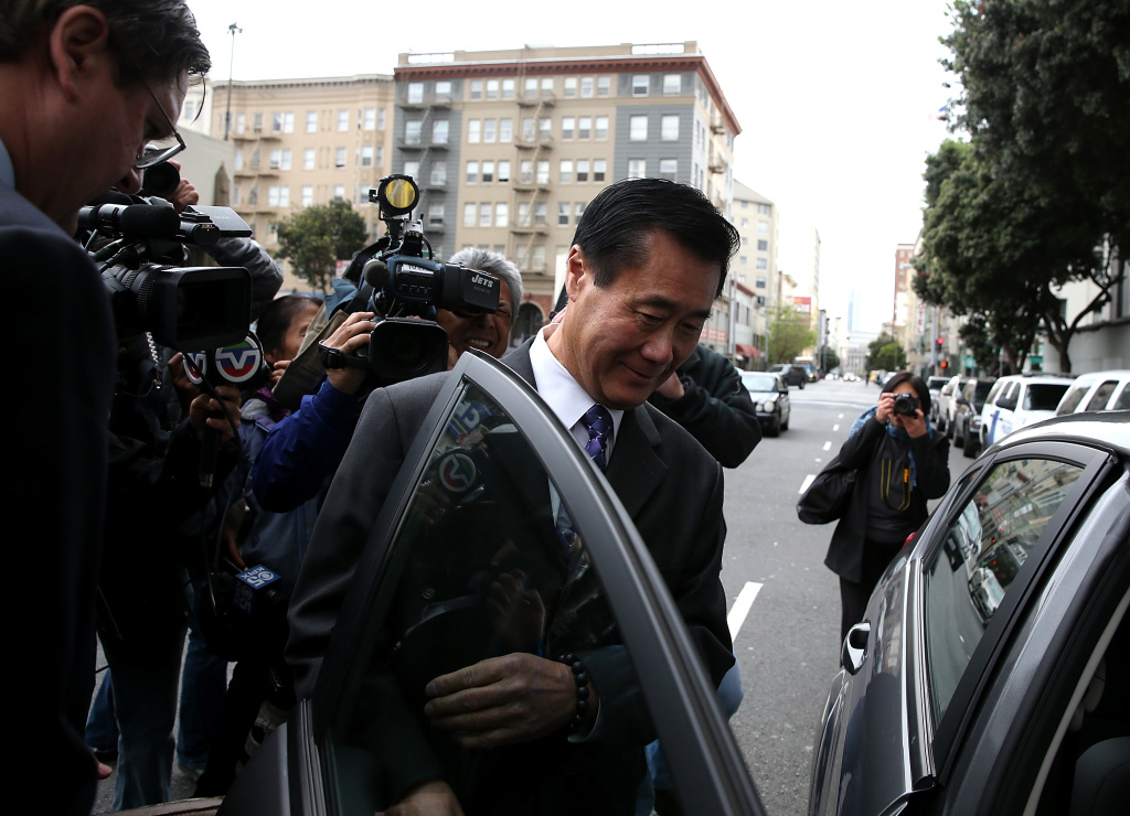 SAN FRANCISCO, CA - MARCH 31:  California State Sen. Leland Yee gets into an awaiting car as he leaves the Phillip Burton Federal Building after a court appearance on March 31, 2014 in San Francisco, California. Yee appeared in federal court today for a second time after being arrested along with 25 others by F.B.I. agents last week on political corruption and firearms trafficking charges. Yee is free on a $500,000 unsecured bond.  (Photo by Justin Sullivan/Getty Images)