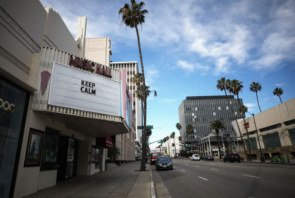 A shuttered movie theater displays the message 'Keep Calm' on the marquee on March 18, 2020 in Beverly Hills, California.