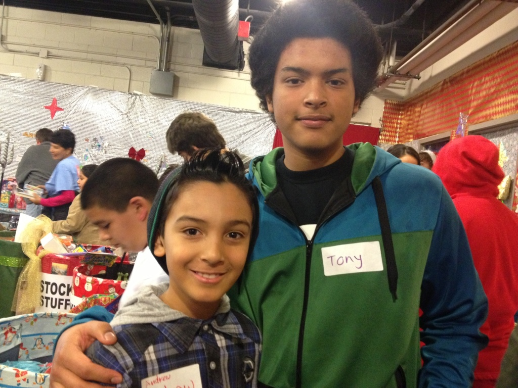 Tony Gasco (right) and his little brother Andrew Veliz traded in Christmas morning at home to volunteer at The Midnight Mission's toy give away.