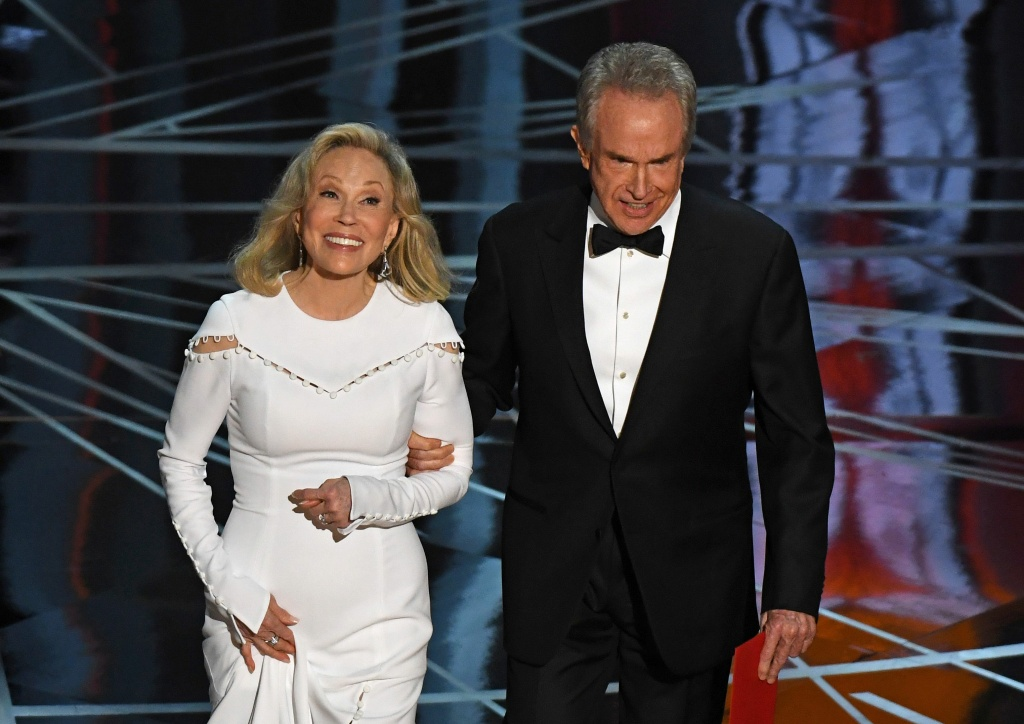 Actress Faye Dunaway and actor Warren Beatty arrive on stage to announce the winner of the Best Movie category at the 89th Oscars on February 26, 2017 in Hollywood, California.
