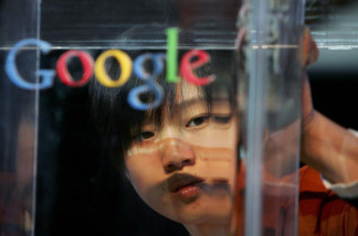 A women polishes a dais before the Google global Chinese name launch on April 12, 2006 in Beijing, China.