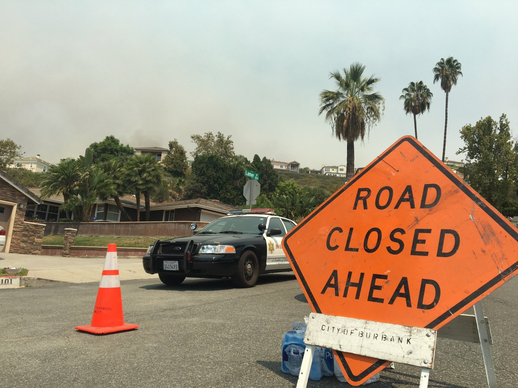 Many roads have been blocked off roads and the smoke is thick near the La Tuna Fire, burning in the hills above Burbank, early September 2, 2017.