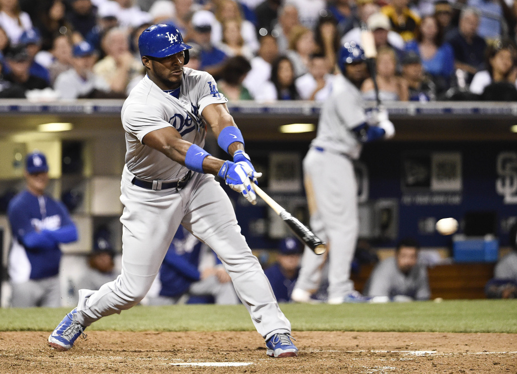 In this file photo, Yasiel Puig #66 of the Los Angeles Dodgers hits a single during the eighth inning of a baseball game against the San Diego Padres at Petco Park August, 30, 2014 in San Diego, California. On Monday, Time Warner Cable announced it had reached a deal that would allow the final six games to be televised.