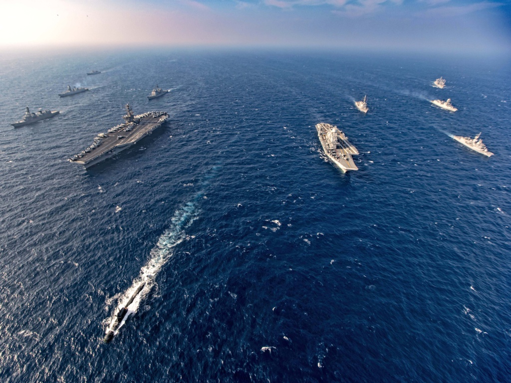 Aircraft carriers and warships participate in the second phase of Malabar naval exercise, a joint exercise by India, the U.S., Japan and Australia, in the northern Arabian Sea last November. The four countries form the Quadrilateral Security Dialogue, or the Quad.