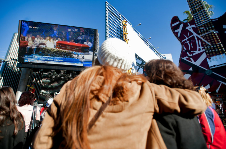 Fans watch a public memorial for 43-year-old banda singer Jenni Rivera at Universal CityWalk on Wednesday. Rivera's family put on the two-hour ceremony, which they called a