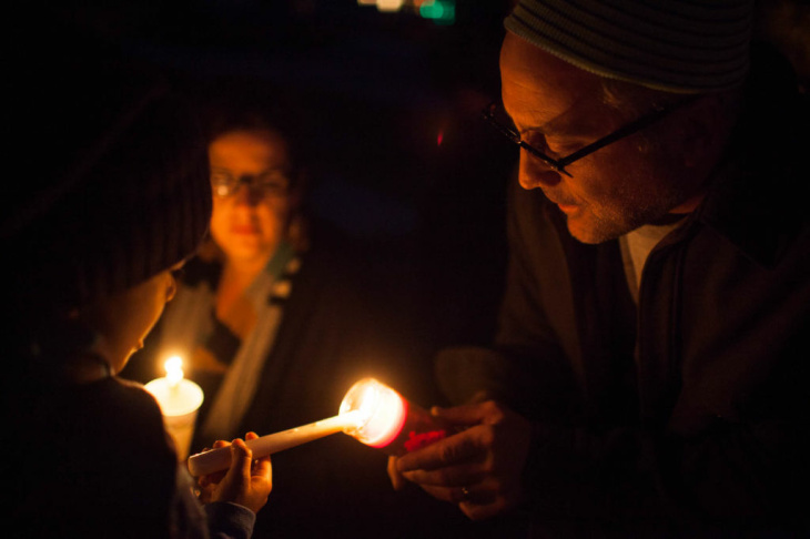 Abby Cohen of Altadena participates in a vigil on December 15 at Glenoaks Park in Glendale for the victims of a mass shooting at Sandy Hook Elementary School in Newtown, Conn.