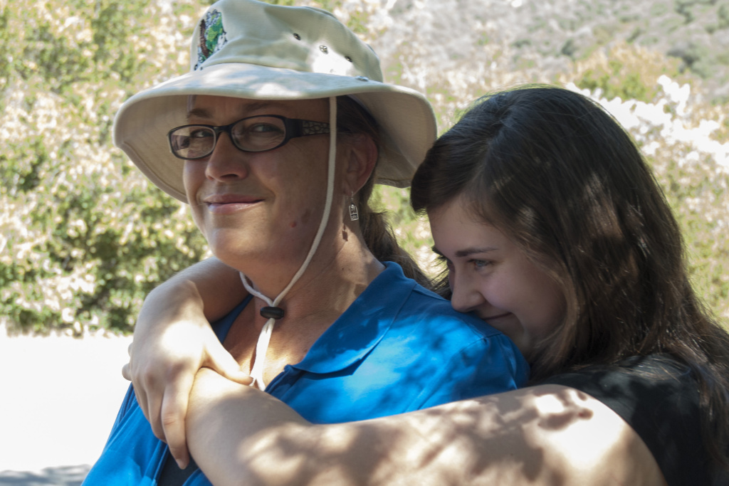 Madeleine Cray (right) hugs her mother Yvonne Brockwell during a tour of Cold Creek in the mountains north of Malibu, Calif., March 15.