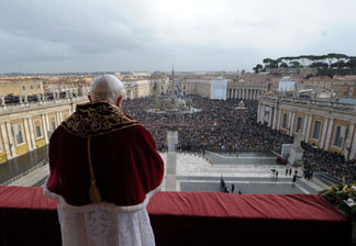 Pope Benedict XVI blessing a crowd from the central balcony of St. Peter's Basilica in Vatican City, Vatican.