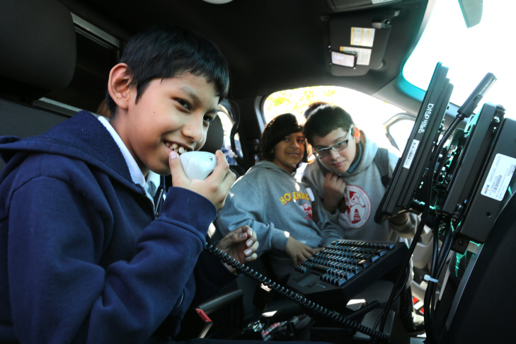 Los Angeles police officer Heidi Stoecklein takes a selfie with Collin Harris,10, during a daylong training on autism with police officers, school police and county Sheriff's deputies in Los Angeles on Thursday, Oct. 9, 2014. About 100 law enforcement officers were paired with 100 autistic students for a unique daylong training program that works to educate both populations about the other in an effort to avoid tragedy.