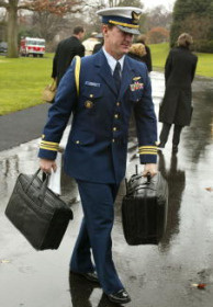 A U.S. Military officer carries the 'football,' which holds the nation's nuclear launch codes