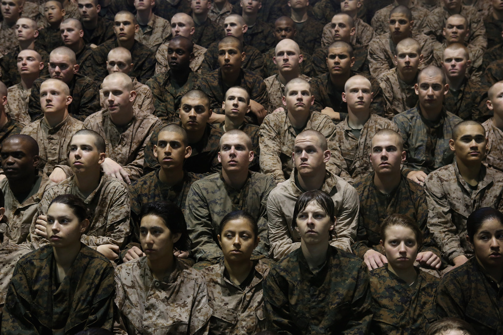 Female and male Marine recruits listen to instructions as they prepare for a swimming test during boot camp at MCRD Parris Island, South Carolina.