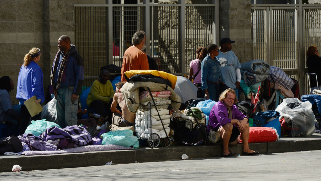 Homeless people rest on a public sidewalk early this year in downtown skid row area of Los Angeles. The United Way of Greater Los Angeles is attempting to end