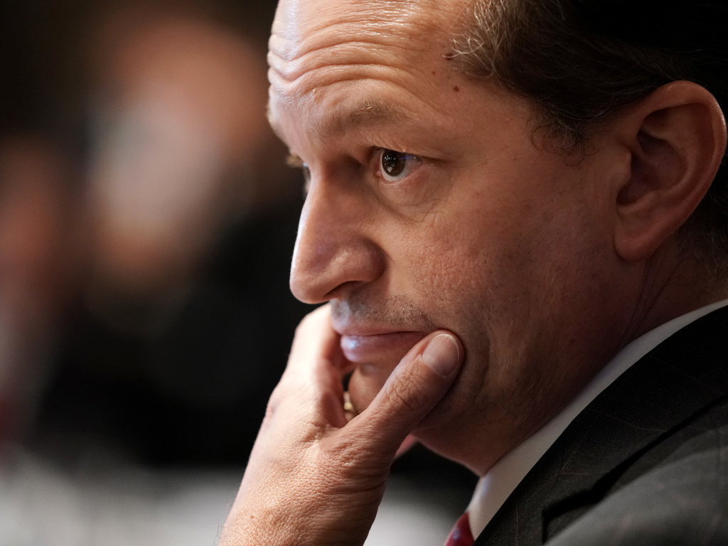 The Justice Department found Thursday that former U.S. Labor Secretary Alexander Acosta, shown here during a 2019 Cabinet meeting at the White House, showed